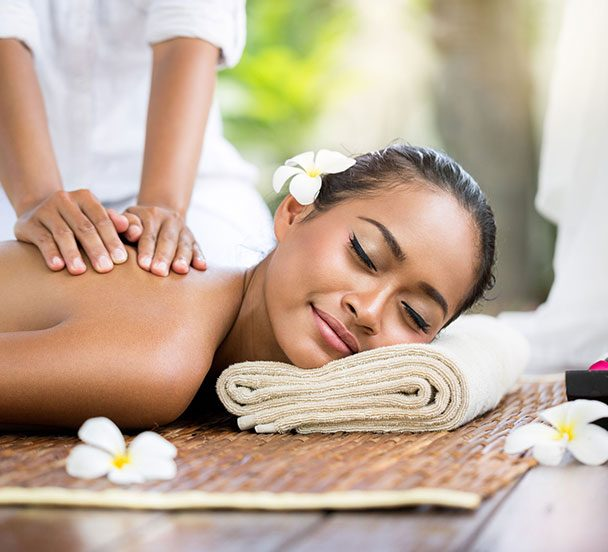 Woman enjoying a Thai massage.