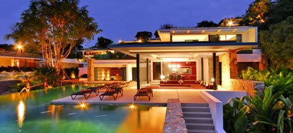 Koh Samui villa exterior with swimming pool, at evening.
