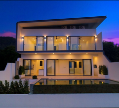 Nice pool villa at sunset with the lights turned on
