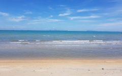 Peaceful beach land view with a calm sea