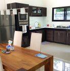 Open plan kitchen/dining in a garden villa