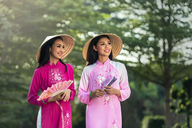 Two Thai women in traditional Thai clothing.