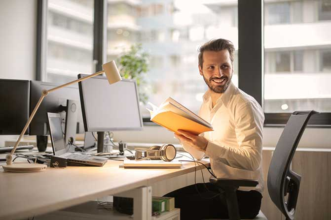 Man sitting at a desk in an office.