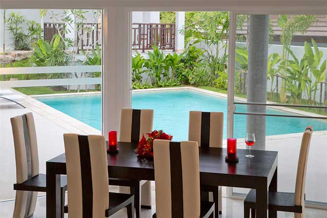 Villa dining room with pool view.