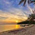 beachfront land with sunset